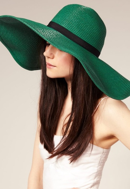 green colored straw hat