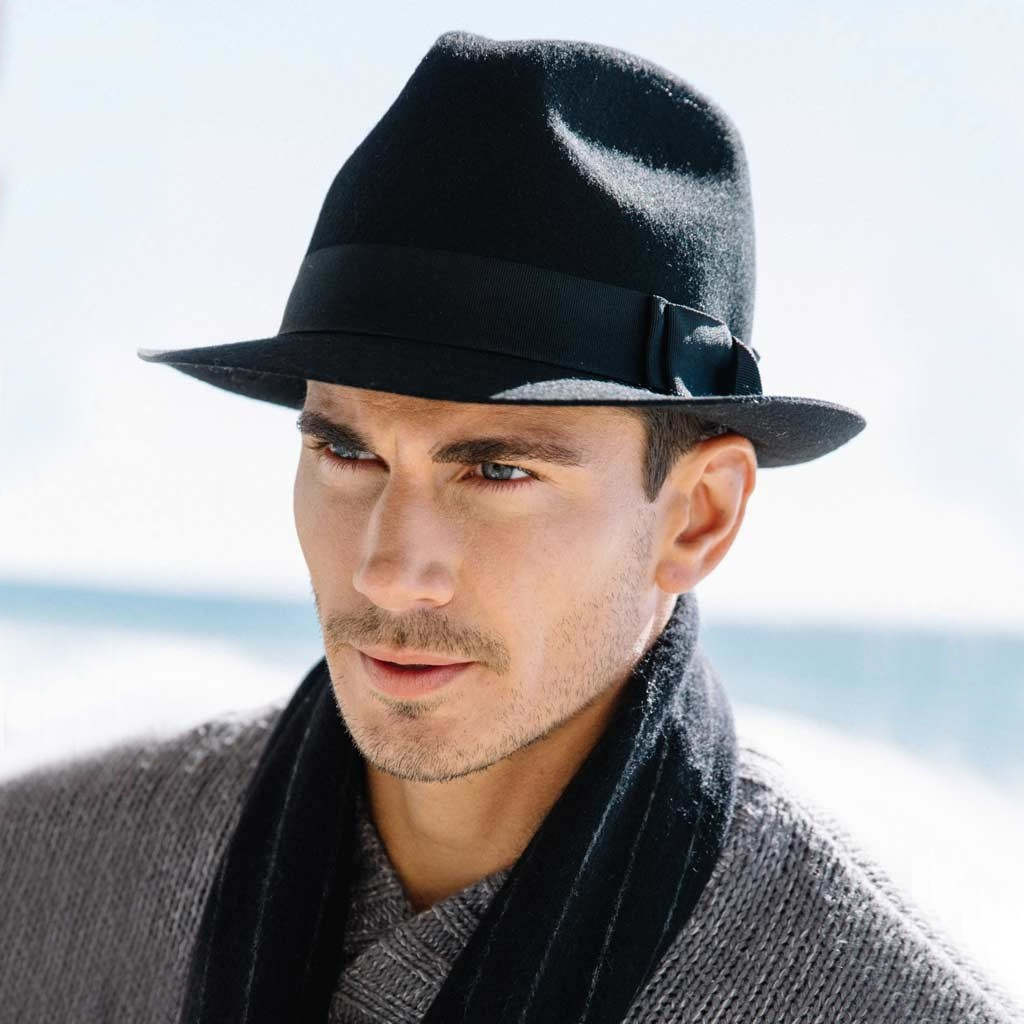 A man in a black felt hat